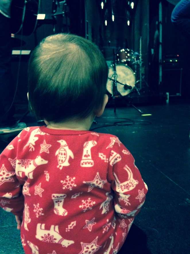 Center stage, watching Daddy play drums.